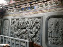Peitian Temple - Back hall of patio `Dragon Carving Wall` stock photography